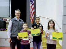 David Groat, KES Principal, with the winners of the KES Spelling Bee.