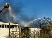 A German firefighter sprays water on a burning factory in Otterberg, near Kaiserslautern, March 23. The building had been on fire since approximately 2 p.m. the previous day and the 86th Civil Engineer Squadron Fire and Emergency services responded at about 4 p.m. to assist with water resupply.