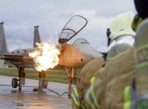 NATO firefighters prepare to extinguish an F-15 Mobile Aircraft Fire Trainer during the NATO Firefighter Fundamentals Course at Ramstein Air Base, March 11. This was the first ever F-15 MAFT asset used on Ramstein. Firefighters from Bulgaria, Latvia, Lithuania and the Czech Republic came to Ramstein to receive certification on extracting pilots and extinguishing aircraft fires.