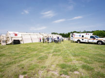 Host nation distinguished visitors watch a simulated ambulance loading and unloading during the 86th Medical Group's exercise Maroon Surge Community Outreach Day on Ramstein Air Base, June 7, 2018. The visitors also received a tour of an Expeditionary Medical System, from the diagnosis room to the surgery room. The 86th MDG designed Community Outreach Day to educate the public on their life-saving capabilities and also invite them to participate in saving lifes by donating blood and bone marrow. Photo by Senior Airman Elizabeth Baker