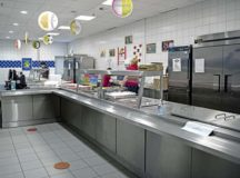 Sonja Gates, Department of Defense Education Activity school meal program manager, walks through the Ramstein Intermediate School kitchen at Ramstein Air Base, March 25. With the outbreak of COVID-19, Gates and cafeteria supervisors from all Ramstein schools came together to create the grab-and-go meal program for students.