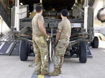 U.S. Air Force Tech. Sgt. William Rodriguez-Febres, 721st Aerial Port Squadron ramp services noncommissioned officer in charge, right, at Ramstein Air Base, assists Airman 1st Class Christian Minjares, 816th Expeditionary Airlift Squadron loadmaster, Al Udeid Air Base, Qatar, pull an engine trailer during a C-17 Globemaster III cargo offload at Ramstein, April 24.