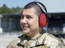 U.S. Air Force Senior Airman Juan Castro, 86th Logistics Readiness Squadron fuels distribution operator, discusses fuels operations at Ramstein Air Base, May 16. Castro was recognized as Airlifter of the Week, a program highlighting outstanding Airmen in the 86th Airlift Wing.