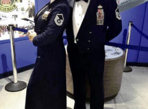 """U.S. Air Force Master Sgt. Amanda """"Mae"""" Arguello, 52nd Fighter Wing deputy chief, wing protocol, and Senior Master Sgt. Alvin """"Al"""" F. Arguello II, Air Force Security Forces Center superintendent of strategic plans and programs, pose for a photo at a ceremony in 2017 at Robins Air Force Base, Georgia. Al and Mae have been coping with the COVID-19 pandemic by continuing to grow in their marriage despite the temporary distance the virus caused."""