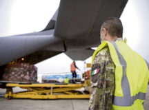 An Italian air force member stands by as a pallet of medical supplies from Milan, Italy is offloaded in Rome, May 13. In response to the ongoing coronavirus disease 2019 outbreak, an 86th Airlift Wing C-130J Super Hercules assisted the Italian government in transporting medical supplies between hubs in Milan and Rome, Italy.