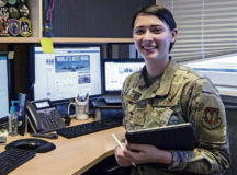 U.S. Air Force Staff. Sgt. Kirsten Brandes, 86th Airlift Wing noncommissioned officer in charge of media, shows off her workstation, Ramstein Air Base, May 28. As the NCOIC of media, Brandes is responsible for crafting posts and creating plans to communicate with the general public and tell the Air Force story.