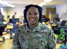 U.S. Air Force Staff Sgt. Jasmine Holcey, 786th Force Support Squadron relocations supervisor, poses for a photo in the base relocations office at Ramstein Air Base, June 1.