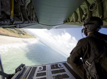 A U.S. Air Force Airman views French beaches from the ramp of a C130J Super Hercules aircraft ramp on June 6. Seventy-six years ago, Allied Forces stormed the beaches of Normandy, France, as part of D-Day to liberate the country from German occupation. To commemorate the anniversary of D-Day, eight C-130J aircraft from the 37th Airlift Squadron based at Ramstein Air Base performed low-level formations over several locations in France. Photo by Staff Sgt. Kirsten Brandes
