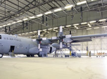A C-130H Hercules ground trainer aircraft rests in a hangar at Ramstein Air Base, June 15. The 86th Maintenance Squadron removed fuel tanks from each wing of the aircraft to use for confined space training.