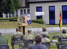U.S. Air Force Brig. Gen. Mark R. August, 86th Airlift Wing commander, speaks at a road dedication ceremony at Ramstein Air Base, June 16. The newly completed Rodriguez Road was named in remembrance of Maj. Rodolfo I. Rodriguez, former 86th Construction and Training Squadron contingency training flight commander, who was killed by a terrorist bomb in Islamabad, Pakistan, Sept. 20, 2008.