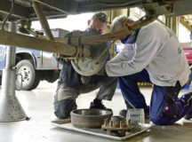 Alexander Geimer, left, and Joerg Engel, both 86th Vehicle Readiness Squadron general purpose heavy mechanics, install a brake assembly on a military tactical trailer at Ramstein Air Base, June 19. Geimer and Engel work with the 86th VRS, which addressed vehicle parts supply challenges by establishing a partnership with local Army supply.