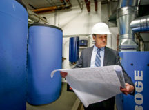 William McCarthy, facility director for Landstuhl Regional Medical Center and Regional Health Command Europe, checks blueprints for recently-installed water treatment equipment at LRMC. McCarthy was recently recognized as the civilian of the year for 2019.