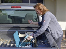 Julia Huber, 86th Civil Engineer Squadron housing inspector, gathers supplies to install new window locks at a townhome in Kaiserslautern Military Community Housing at Vogelweh Military Complex, July 20. The new safety locks, installed on upper-level townhome windows to provide fall protection, are part of a Department of Defense safety initiative to mitigate risk and ensure the well-being of military families.