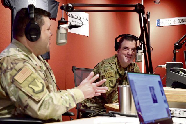 U.S. Air Force Brig. Gen. Mark R. August, 86th Airlift Wing commander, right, and Chief Master Sgt. Ernesto J. Rendon, 86th AW command chief, discuss their time spent as the 86th AW command team at the American Forces Network Kaiserslautern radio station at Vogelweh Military Complex, July 24. Before parting ways with the 86th AW, August and Rendon shared their proudest accomplishments and answered questions about what they valued most during their assignment.