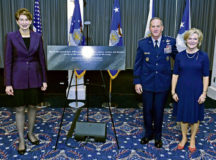 """Secretary of the Air Force Barbara M. Barrett, left, Air Force Chief of Staff David L. Goldfein and Mrs. Dawn Goldfein pose with a representation of an etching that is now displayed on the Wall of Valor at the Air Force Memorial during a ceremony at Joint Base Anacostia-Bolling, Washington, D.C., July 31. The ceremony unveiled a new etching for the memorial's Wall of Valor at the Air Force Memorial that reads, """"This is our sacred duty. When protecting Soldiers, Sailors, Airmen and Marines, we fly to the sound of the guns … or we die trying."""" Photo by Wayne Clark"""