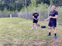 Sgt. 1st Class Brandon Johnson, assigned to the 11th Missile Defense Battery, 10th Army Air and Missile Defense Command, teaches form and technique about the sprint, drag, carry ACFT event at Ramstein Air Base, on July 29.