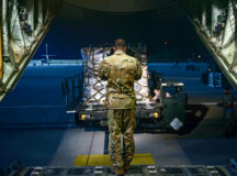 U.S. Air Force Staff Sgt. Brian Clark, 37th Airlift Squadron loadmaster, directs a cargo loader at Ramstein Air Base, Aug. 13. Ramstein Airmen transported COVID-19 personal protection equipment purchased by U.S. Africa Command to South Africa. The supplies included N-95 masks, gloves, gowns and sanitizer. Photo by Staff Sgt. Jourdan Barrons