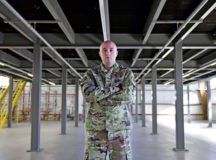 U.S. Air Force Staff Sgt. Zachary R. Tingen, 86th Maintenance Squadron programs manager, poses for a photo at a multi-use maintenance facility, one of four construction projects he has overseen at Ramstein Air Base, Germany, Sept. 9, 2020. Tingen's facility construction project efforts resulted in the fusion of three flights into a 56,000 square foot hangar, increasing C-130J Super Hercules aircraft letter check manpower by 65%. (U.S. Air Force photo by Airman 1st Class John R. Wright)