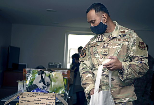 U.S. Air Force Staff Sgt. Shranil Kumar, 86th Civil Engineer Squadron Airmen Dorm Leader, puts an assortment of snacks into a welcome bag for incoming junior Airmen who will be required to self-quarantine on Ramstein Air Base, Germany, Oct. 8, 2020. Kumar and 12 others volunteered to put welcome bags together to make the transition to Germany a little easier for incoming Airmen who have to quarantine upon arrival. (U.S. Air Force photo by Senior Airman Kristof J. Rixmann)