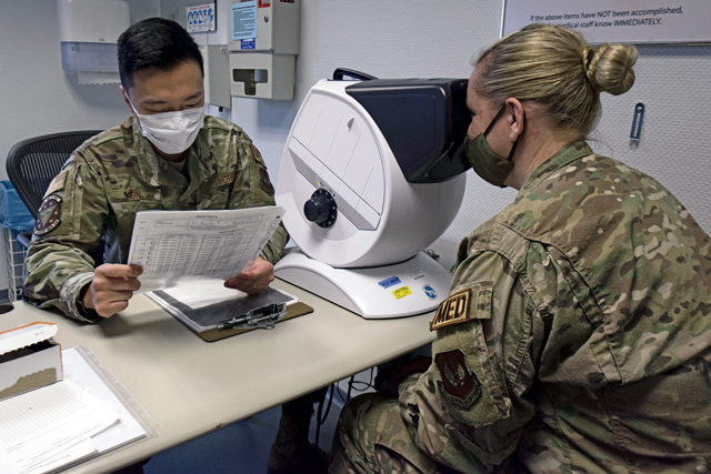 U.S. Air Force Tech Sgt. Sung Min Son, 86th Medical Group flight medicine technician, performs an eye examination at Ramstein Air Base, Germany, Oct. 13, 2020. Son is part of The Language Enabled Airman Program, which teaches many different languages, varying from Spanish to Arabic. (U.S. Air Force photo by Airman 1st Class Taylor D. Slater)