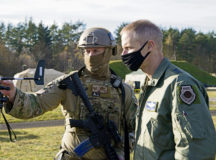 U.S. Air Force Tech. Sgt. Cameron Piontek, 435th Contingency Response Squadron contingency air traffic controller, left, shows Maj. Gen. Derek France, Headquarters U.S. Air Forces in Europe-Air Forces Africa strategic deterrence and nuclear integration operations director, a joint-terminal attack controller wind meter during exercise Agile Wolf 21-01 at Grafenwoehr Training Area, Germany, Nov. 18, 2020. France toured the 435th CRG's expeditionary site to meet Airmen and gain insight on their objectives and capabilities. Agile Wolf 21-01 was designed to sharpen the 435th Contingency Response Group's tactics, techniques and procedures for establishing expeditionary airfields on demand. (U.S. Air Force photo by Senior Airman Milton Hamilton)