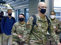 Passengers depart from an aircraft in the Ramstein Passenger Terminal at Ramstein Air Base, Germany, Dec. 9, 2020. As part of COVID-19 guidelines, all visitors are required to wear face coverings. (U.S. Air Force photo by Airman 1st Class Taylor D. Slater)