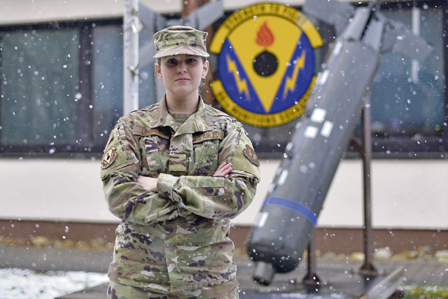 U.S. Air Force Airman 1st Class Taylor Harris, 86th Munitions Squadron custody account technician, poses for a photo in front of the 86th MUNS building at Ramstein Air Base, Germany, Jan. 8, 2021. Harris was recognized as Airlifter of the Week for providing premier customer support for munitions accounts spanning across the 86th Airlift Wing and five geographically separated units. (U.S. Air Force photo by Senior Airman John R. Wright)