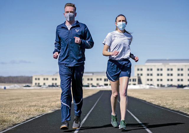 Air Force Uniform Office members 1st Lt. Avery Thompson and 2nd Lt. Maverick Wilhite put updated versions of the Air Force phyisical training (PT) uniform through their paces at Wright-Patterson Air Force Base, Ohio, Feb. 25, 2021.  The Air Force Uniform Office is part of the Human System's Division in the Air Force Life Cycle Management Center's Agile Combat Support Directorate. This is the first update to the PT uniform in more than 16 years, and over 150 Airmen participated in testing the new gear. The new ensemble currently consists of a jacket, a pair of pants, a T-shirt and two types of shorts; a lined runner's short and a longer unlined multipurpose short. A long sleeve t-shirt and a hoodie are in development. The ensemble features improved fabrics that are softer and quick drying, and have antimicrobial technology, which helps with moisture and odor control. The new uniform items are entering the production phase and will be available to Airmen sometime in 2022. (U.S. Air Force photo by Jim Varhegyi)