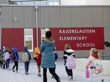 First grade students enter Kaiserslautern Elementary School at Kapaun Air Station, Germany, April 7, 2021. Students returned from spring break to finish the school year in the new KES building. (U.S. Air Force photo by Staff Sgt. Leah Ritchey)