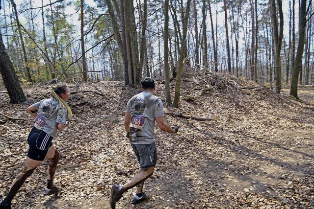 Participants compete in Wild Boar Mud Run