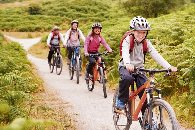 Family riding mountain bikes