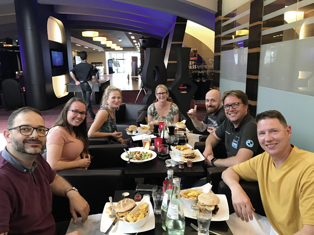 Group of friends eating after a day at the track