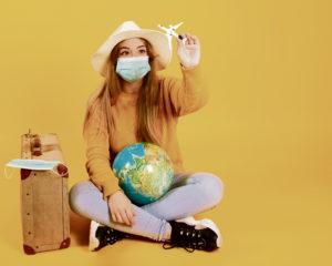 Woman with mask fantasizing about traveling