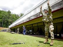 U.S. Army Spc. Phillip Xu, pharmacy technician, Landstuhl Regional Medical Center, performs a burpee with full combat gear during the stress shoot portion of LRMC's Best Warrior Competition, July 7. The competition challenged Soldiers from across Germany, Belgium and Italy, physically, emotionally and spiritually as they were tested on various tasks and skills including Army Warrior Tasks, medical knowledge and prolonged field care, stress shoot, military Drill and ceremony, ruck marches, land navigation, combat lifesaving under pressure, combat water survival, and written and oral examinations.