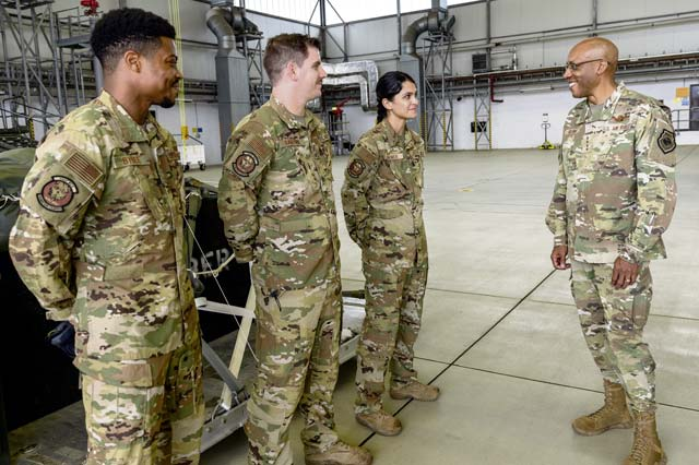 Right to left: Air Force Chief of Staff Gen. CQ Brown, Jr.; talks to 1st Lt. Miolani Grenier, U.S. Air Forces in Europe – Air Forces Africa Intelligence, Surveillance, Reconnaissance capabilities and development deputy chief, Tech. Sgt. Eric Dafforn, 86th Operations Support Squadron Air Traffic Control watch supervisor; and Senior Airman Jordan Bybee, 86th OSS intelligence analyst, during their Multi-Capable Airmen display during his visit to Ramstein Air Base, July 15. Brown took the time to meet with Airmen and get a first-hand look at Ramstein's unique capabilities after delivering a message of collective defense and airpower to allies and partners at the inaugural Chief of the Air Staff's Global Air Chiefs' Conference.  — Photo by Senior Airman John R. Wright