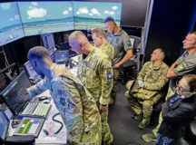 U.S. Air Force Staff Sgt. Jalah Patten, 86th Operations Support Squadron air traffic control tower watch supervisor, left, shows members of the Ukrainian armed forces a tower simulator system during their visit to Ramstein Air Base, Germany, Aug. 5, 2021. The system allows ATC Airmen to train on airspace and airfield navigation and management on multiple simulated U.S. Air Force bases. The Ukrainian service members were able to review fundamental concepts to potentially enable them to host a variety of U.S. Air Force and NATO aircraft at their installations. (U.S. Air Force photo by Senior Airman John R. Wright)