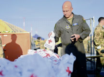 U.S. Air Force Brig. Gen. Josh Olson, 86th Airlift Wing commander, holds a comfort kit provided by the American Red Cross at Ramstein Air Base, Germany, Aug. 20, 2021. Ramstein Air Base is providing safe, temporary lodging for qualified evacuees from Afghanistan as part of Operation Allies Refuge during the next several weeks. Operation Allies Refuge is facilitating the quick, safe evacuation of U.S. citizens, Special Immigrant Visa applicants and other at-risk Afghans from Afghanistan. Qualified evacuees will receive support, such as temporary lodging, food, medical screening and treatment and more, while housed at Ramstein Air Base while preparing for onward movements to their final destinations. (U.S. Air Force photo by Senior Airman Jan K. Valle)